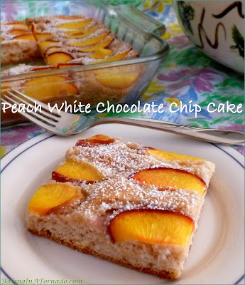 Peach White Chocolate Chip Cake starts with a boxed cake mix. Fresh peaches, cinnamon and white chocolate chips add fresh summer flavors. | Recipe developed by www.BakingInATornado.com | #recipe #cake