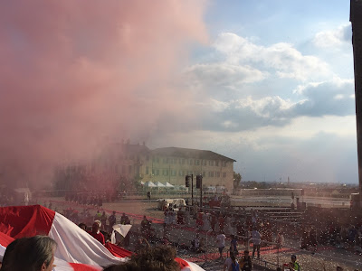 Red smoke from the Borgo San Bernardo fans.