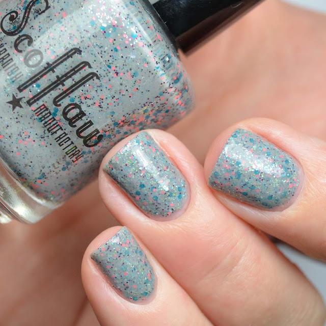 grey nail polish with pink and blue glitter swatch