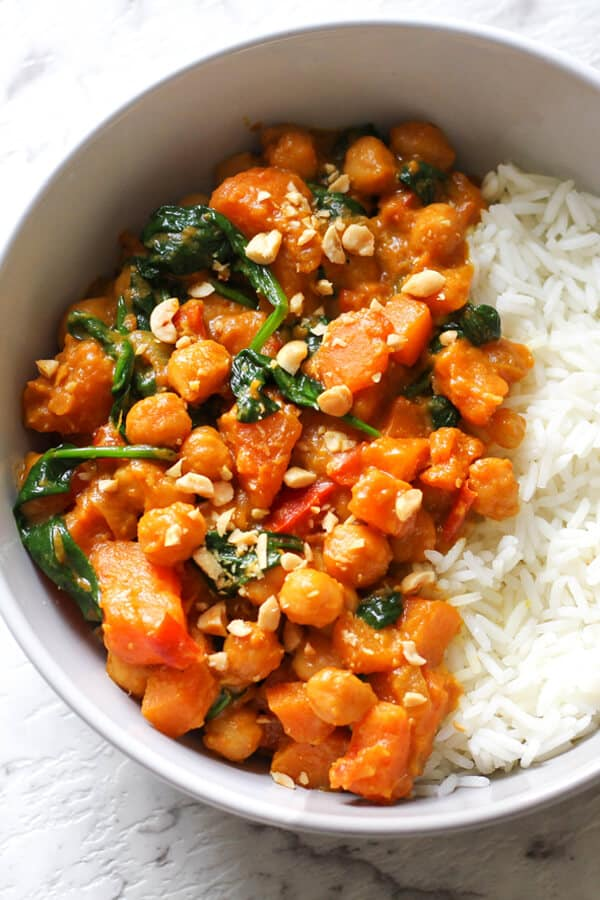 Sweet Potato, Chickpea and Spinach Curry - This easy and healthy Sweet Potato, Chickpea and Spinach Curry is a 30 minute one pot wonder! This vegan and gluten-free dish uses yellow curry paste and coconut milk as a base to make a seriously delicious and creamy curry.