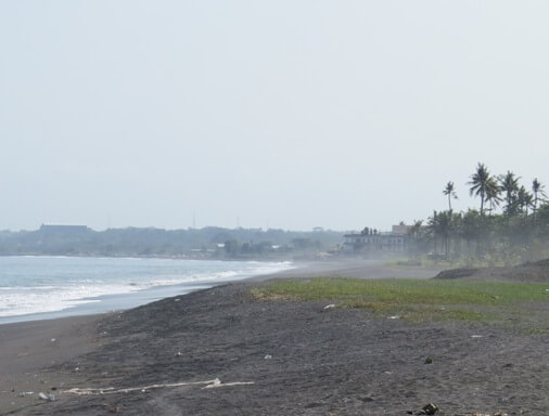 Lepang Beach Bali is a dramatic dark sand beach amongst clear bluish H2O BeachesinBali: Lepang Beach - Pantai Lepang Bali