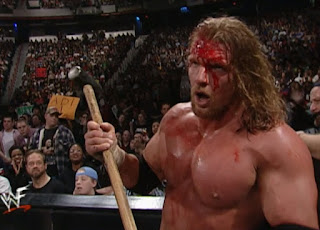 WWE / WWF No Way Out 2001 -  A Bloody Triple H prepares to drill Steve Austin with Sledgehammer