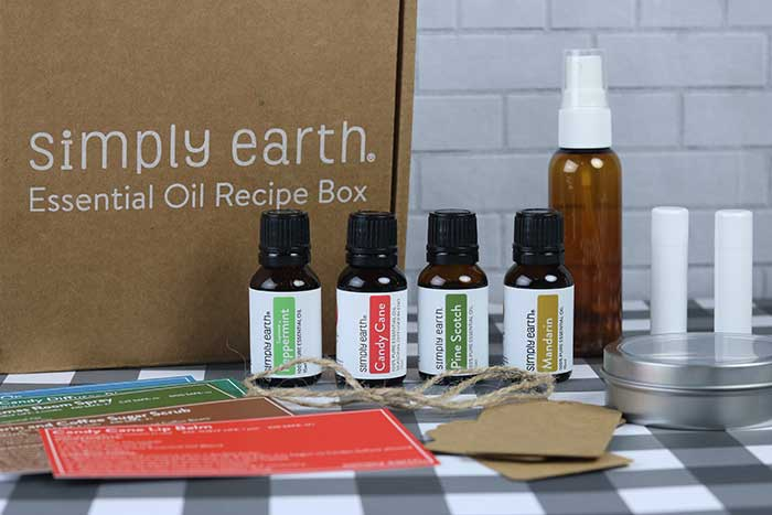 How to make 6 easy essenital oil gifts at home. These are great Christmas ideas for teachers, for friends, or even for Mother's Day or another holiday. Learn how to make a lip balm, roller blend, air freshener, coffee sugar scrub, and more products. Combine them for a simple basket set.  DIY homemade gifts are easy to make these with these recipes. #essentialoils #diy #gift #diygift