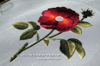 Showing the glow of the silk embroidery threads on a thread painted rose (design by Trish Burr)
