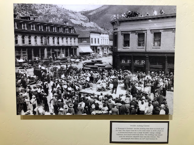 old black-and-white photo of town square with a festival going on