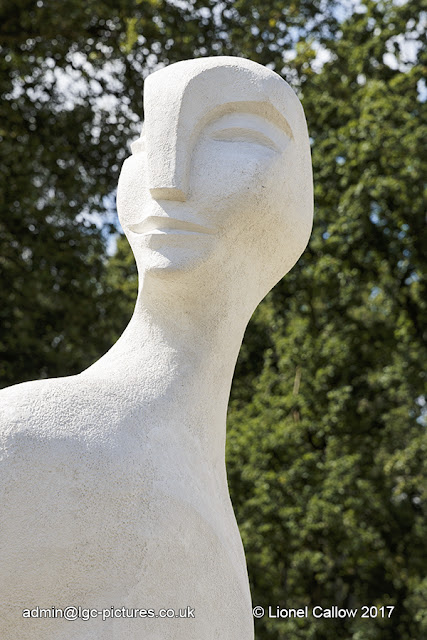 sculpture is a stone resin of a head and shoulders full face