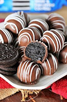Plate of Classic Oreo Balls with One Cut in Half to Show Inside Image