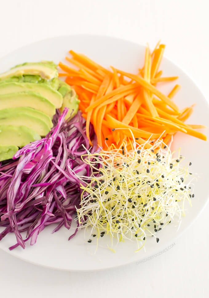 Summer roll ingredients: red cabbage, carrot, garlic sprouts and avocado