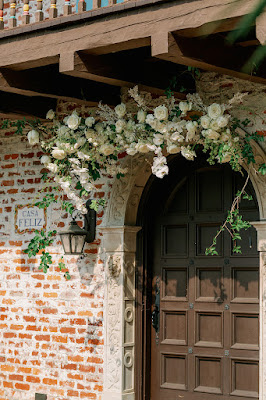 casa feliz wooden door with floral