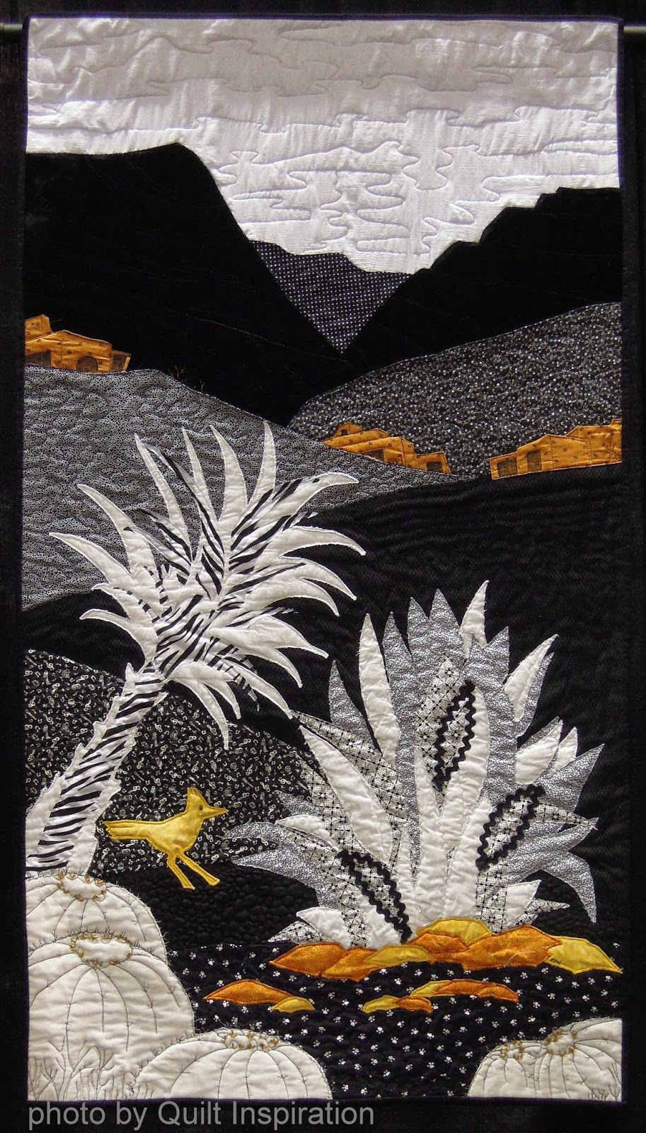 Black and white desert by eileen wintemute 2013 piqf we admire the graphic cactus shapes and the touches of golden yellow that enliven this quilt