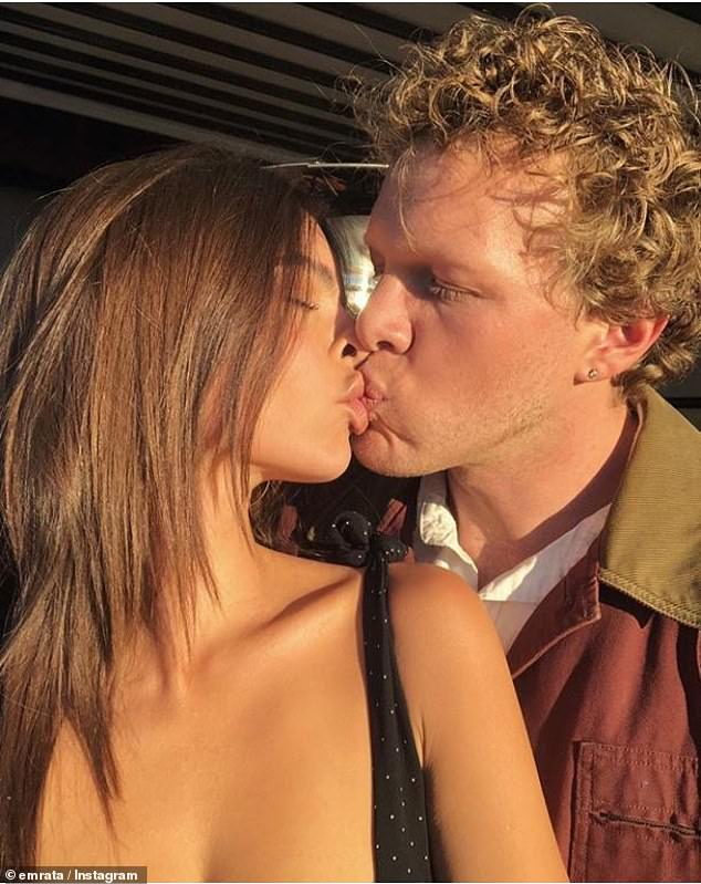 Emily Ratajkowski shares a passionate kiss with husband Sebastian Bear-McClard