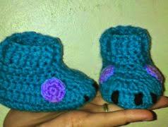 http://crocheteandoconimaginacion.blogspot.com.es/2014/06/botitas-sully.html