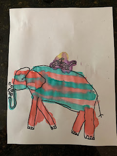 A drawing of a pink and green elephant with a turtle on its back.