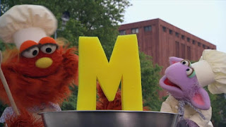 The letter of day is M, Murray and Ovejita Alphabet Cookoff, Sesame Street Episode 4312 Elmo and Zoe's Hat Contest season 43