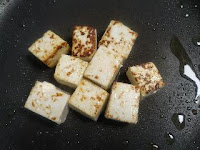 Frying paneer cubes in pan for paneer masala recipe