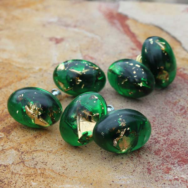 Emerald green resin with gold leaf suspended inside and made into dresser knobs