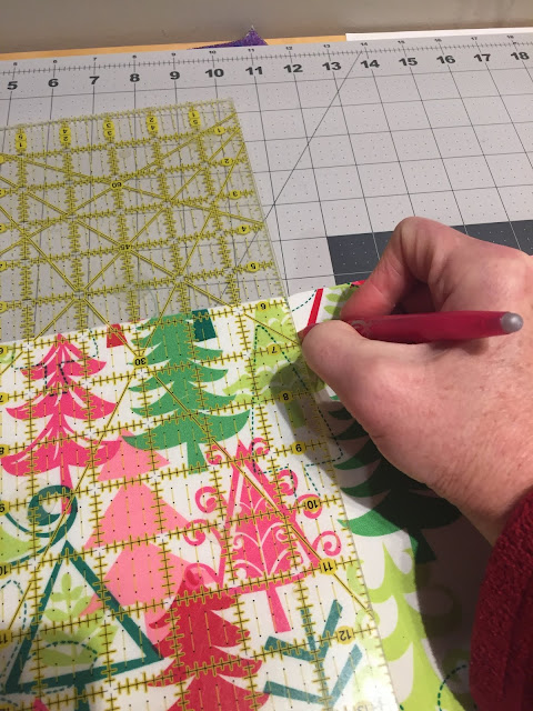 piece of holiday fabric with measurement for quilting lines
