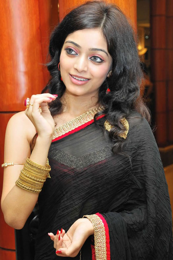 South Indian Actress Janani Iyer Long hair Hot Hip Navel Stills In Transparent Black Saree