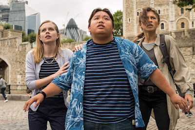 Angourie Rice, Jacob Batalon, and Zendaya look upon the destrustion of a European city in a movie still for Marvel's Spider-Man: Far from Home