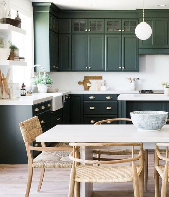 Modern kitchen with dark green cabinets