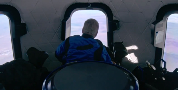 William Shatner looks out the window during his NS-18 flight aboard Blue Origin's New Shepard capsule above Texas...on October 13, 2021.