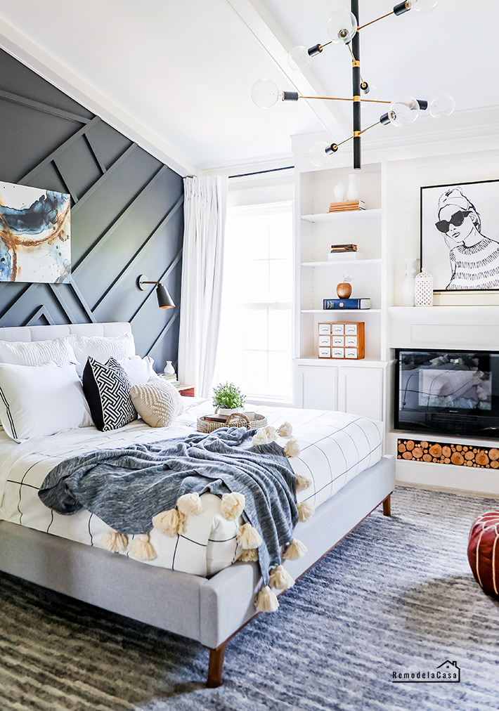 bedroom with dark accent wall