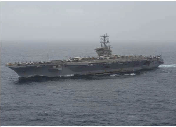 The American carrier crossed the Strait of Hormuz during tensions with Iran