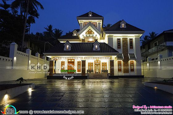 Superb looking real life photograph of Kerala style sloping roof house in night view