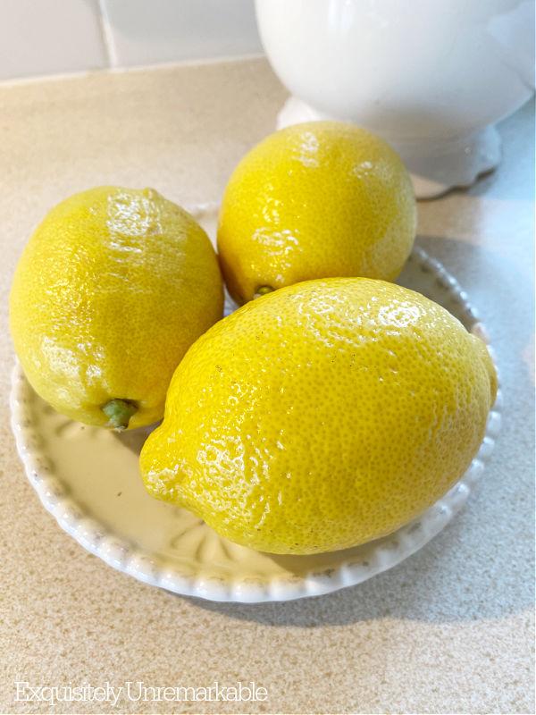 Three Lemons On A Dish