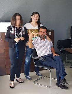 Седат Игдеджи на работе с семьей