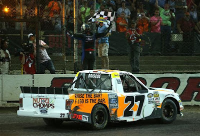 Chase Briscoe, driver of the #27 Ford Ford, celebrates with the checkered flag after winning the NASCAR Camping World Truck Series Eldora Dirt Derby at Eldora Speedway on July 18, 2018 in Rossburg, Ohio.