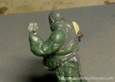 Several pieces of greenstuff roughly placed on the wire on the Putrid Blightkings arm, showing the first shape of it.