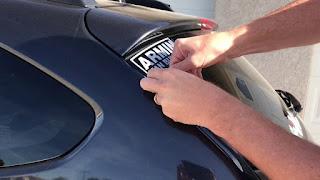 Taking off the sticky bumper sticker