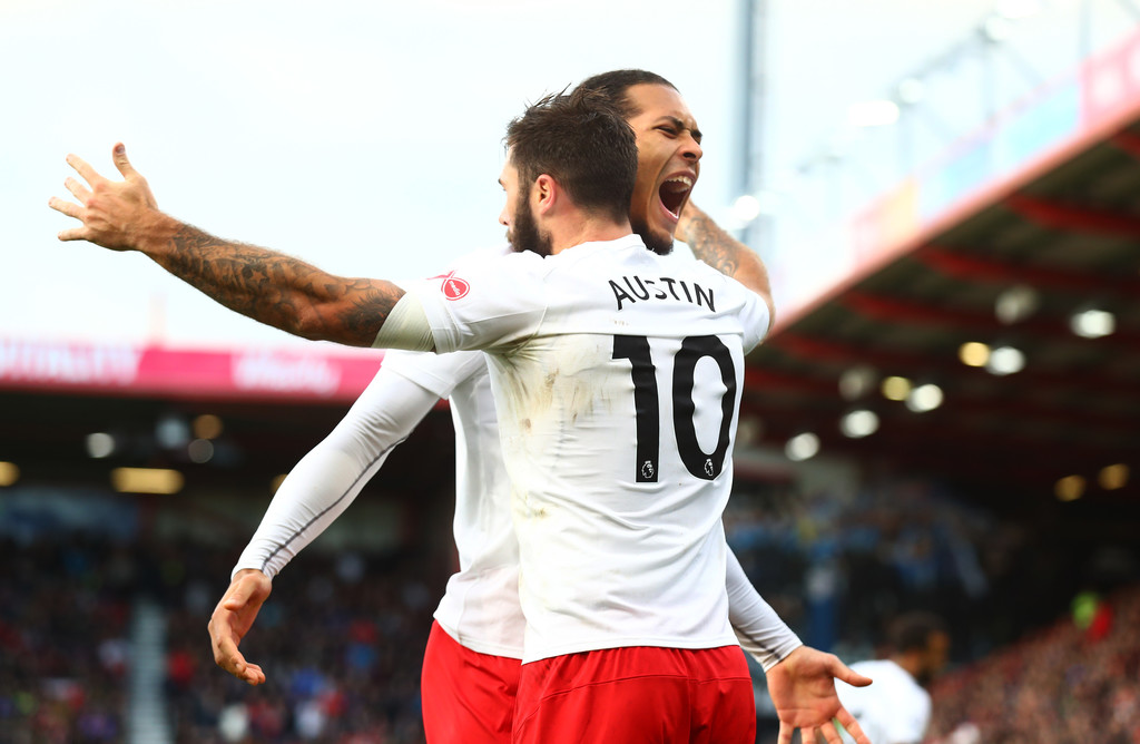 Charlie Austin of Southampton celebrates after scoring his sides first goal with Virgil van Dijk of Southampton during the Premier League match between AFC Bournemouth and Southampton at Vitality Stadium on December 3, 2017 in Bournemouth, England