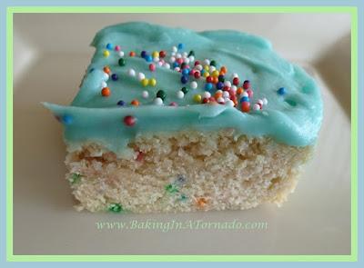 Confetti Cookie Bars with Berry Frosting | recipe developed by www.BakingInATornado.com | #recipe #dessert