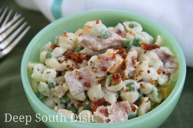 Classic peas and pasta salad, made with tiny shell pasta and dressed with homemade buttermilk Ranch, spicy mustard, dill, red onion, cubed cheese, bacon and gently tossed with tuna fillets.