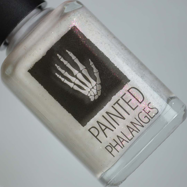 white nail polish with pink shimmer in a bottle