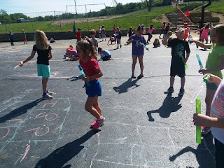 Group of students playing four hop scotch