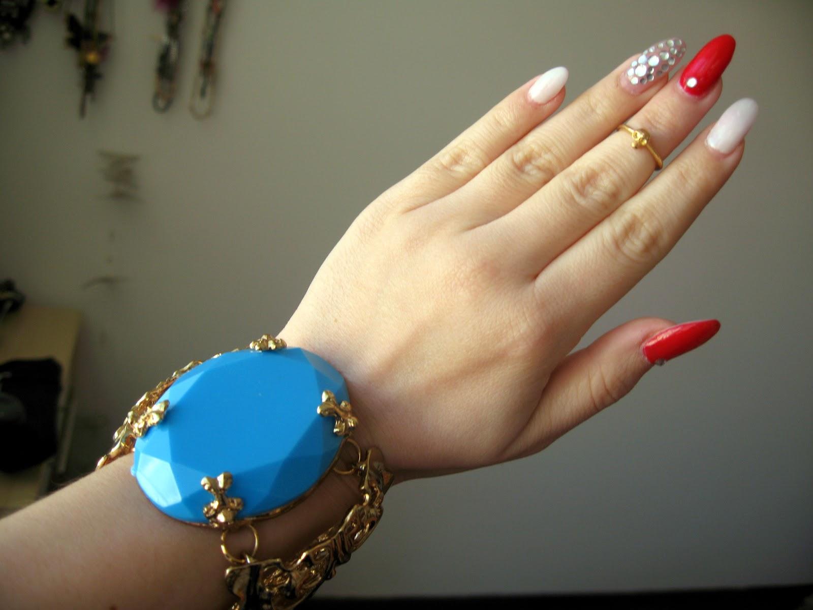 statement bracelet, red and white stiletto nails,