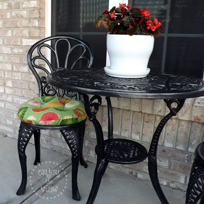 painted wrought iron table and chair