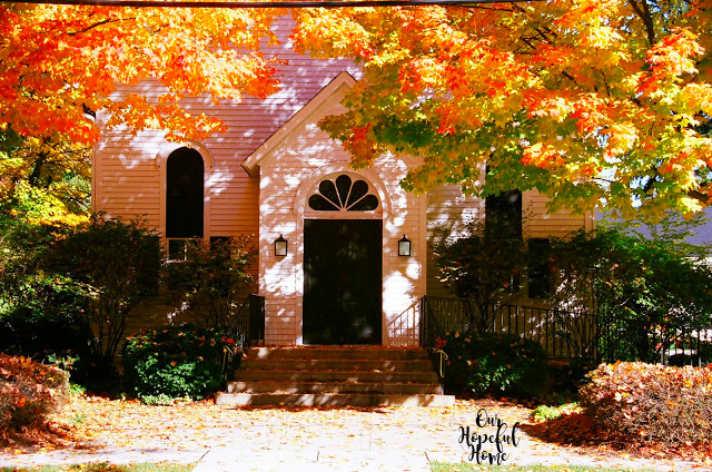 white church fall trees orange leaves