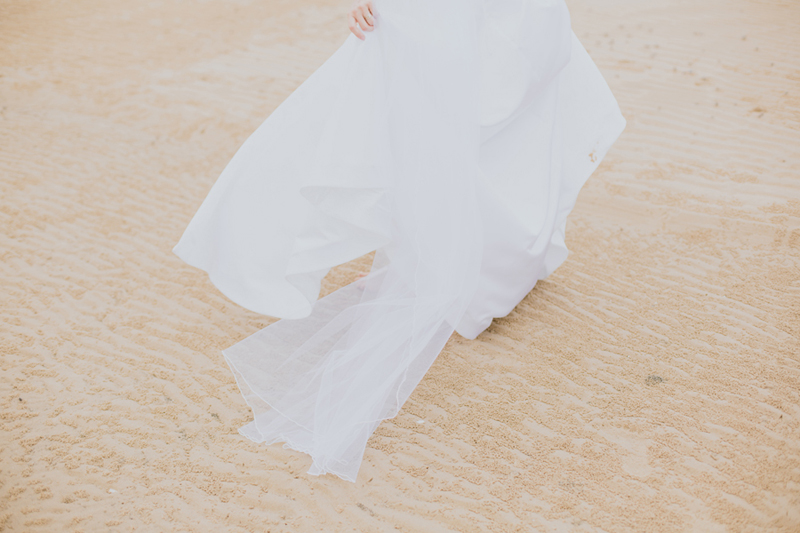 back of bride's dress on sand