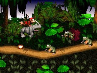 Captura de pantalla de DK Country en el que aparece Diddy Kong subido a un rinoceronte