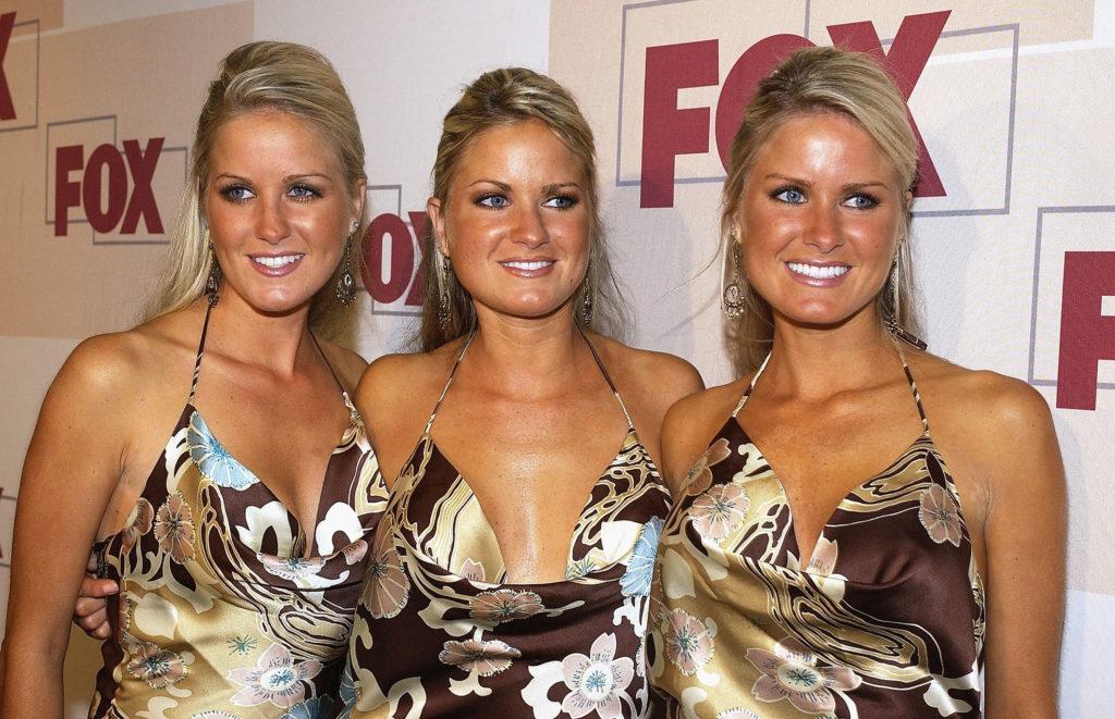 image Three hot blondes take turns sucking on one hard cock