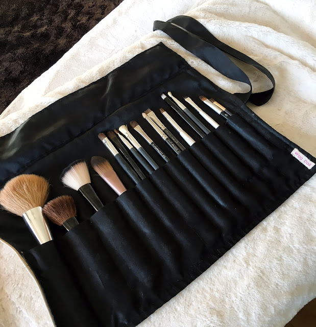make-up brushes in a roll