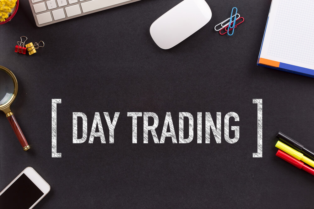day trading written in the middle of  a clutter of tools
