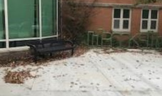 Bench with new bike rack at branch entrance