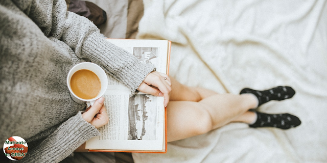"Header image of the article: ""5 Ways To Simplify Your Life And Avoid Exhaustion"". Woman relax, cup of coffee, reading book, socks, bed. avoiding exhaustion"