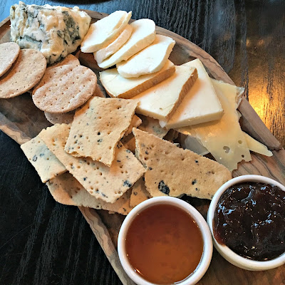 Selection of Italian cheeses served with crackers, honey and chutney