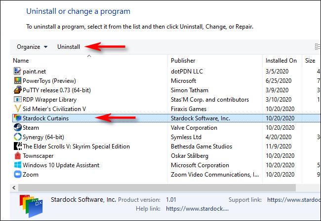 """في البرامج والميزات ، حدد التطبيق الذي تريد إلغاء تثبيته وانقر فوق """"إلغاء التثبيت""""."""